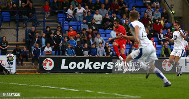 Danny Ings of Liverpool scores the only goal of the game during the PreSeason Friendly match between Tranmere Rovers and Liverpool at Prenton Park on...