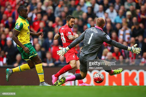 Danny Ings of Liverpool shoots past goalkeeper John Ruddy of Norwich City to score their first goal during the Barclays Premier League match between...