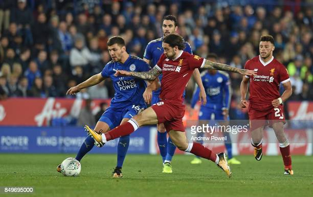 Danny Ings of Liverpool with Aleksandar Dragovic of leicester during the Carabao Cup third round match between Leicester City and Liverpool at The...