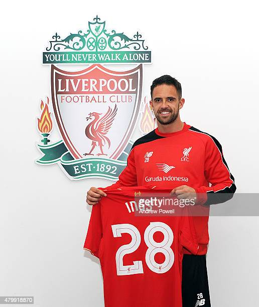 Danny Ings poses with his shirt as he is unveiled as the new signing for Liverpool at Melwood Training Ground on July 8 2015 in Liverpool England