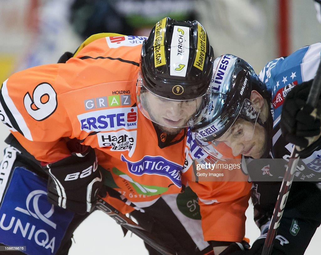 Danny Irmen of Linz (R) challenges Robert Wren of Graz during the Erste Bank Eishockey Liga match between Black Wings Linz and Moser Medical Graz99ers at Keine Sorgen EisArena on December 21, 2012 in Linz, Austria.