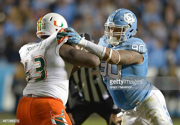Danny Isidora of the Miami Hurricanes blocks Nazair Jones of the North Carolina Tar Heels during their game at Kenan Stadium on November 14 2015 in...