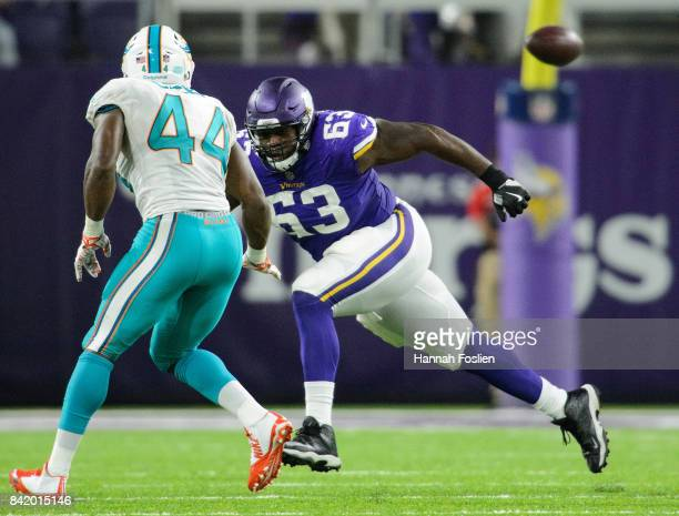 Danny Isidora of the Minnesota Vikings blocks Deon Lacey of the Miami Dolphins in the preseason game on August 31 2017 at US Bank Stadium in...