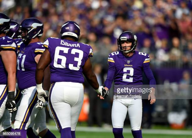 Danny Isidora of the Minnesota Vikings celebrates a successful field goal attempt with kicker Kai Forbath in the first half of the game against the...