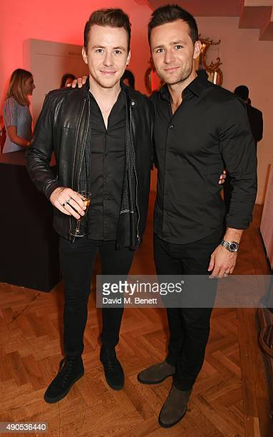 Danny Jones and Harry Judd attend 'Above / Beyond' hosted by American Airlines at One Marylebone on September 29 2015 in London England