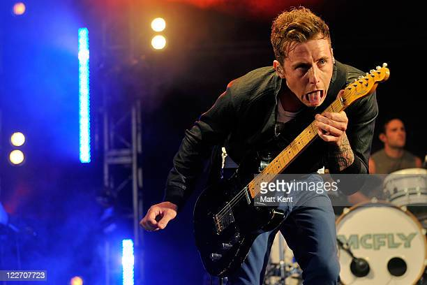 Danny Jones and Harry Judd of McFly perform at Hampton Court Green on August 28 2011 in Kingston upon Thames England