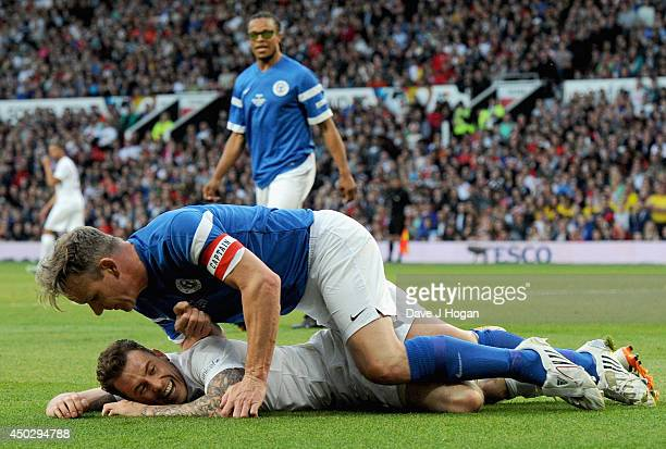 Danny Jones of England share a joke with Gordon Ramsay of the Rest of the World during Soccer Aid 2014 at Old Trafford on June 8 2014 in Manchester...