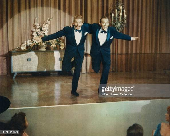 Danny Kaye 1913–1987 and Bing Crosby dancing on stage in a publicity still issued for the film 'White Christmas' USA 1954 The 1954 musical directed...