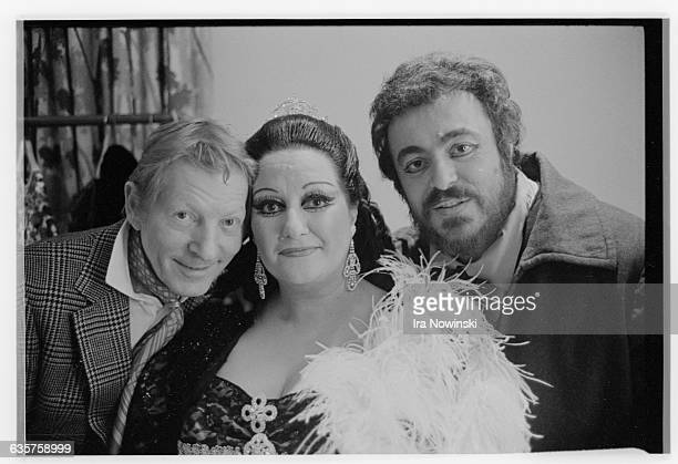 Danny Kaye stands in a dressing room with Montserrat Caballe and Luciano Pavarotti at the San Francisco Opera House Pavarotti as Mario Cavaradossi...