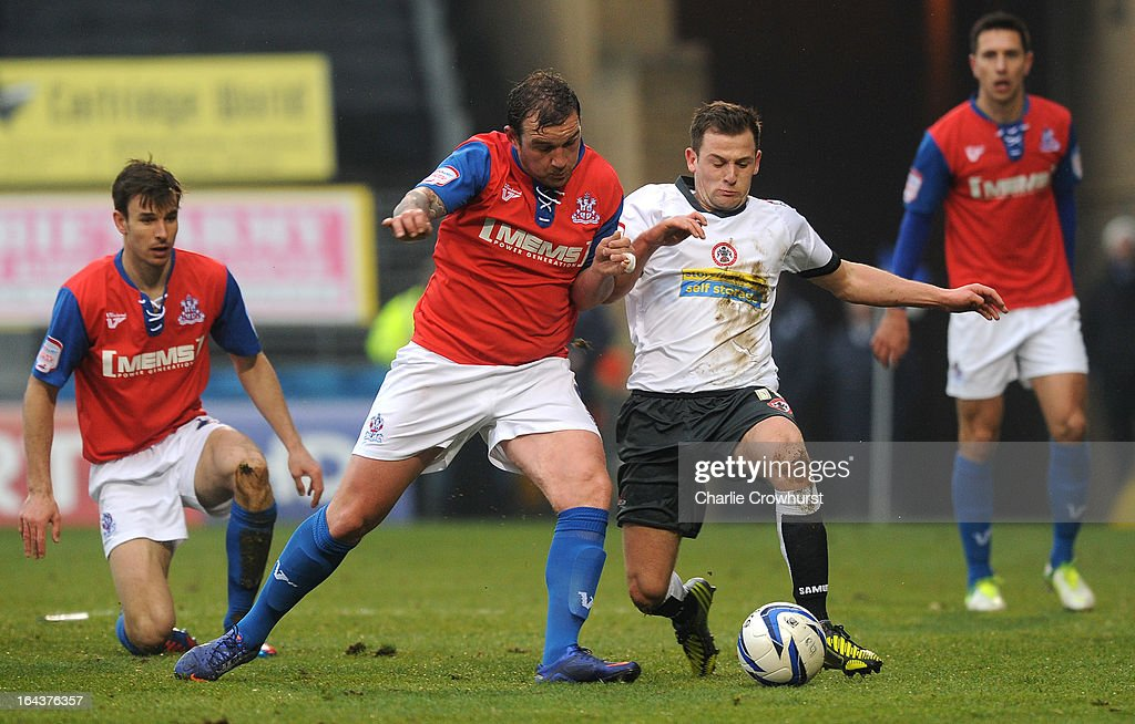 Danny Kedwell of Gillingham clashes with Will Hatfield of Accrington Stanley during the npower League Two match between Gillingham and Accrington Stanley at The Priestfield Stadium on March 23, 2013 in Gillingham, England,