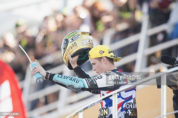 Danny Kent of Britain and Leopard Racing celebrates the victory of the Moto3 championship at the end of the Moto3 race during the MotoGP of Valencia...