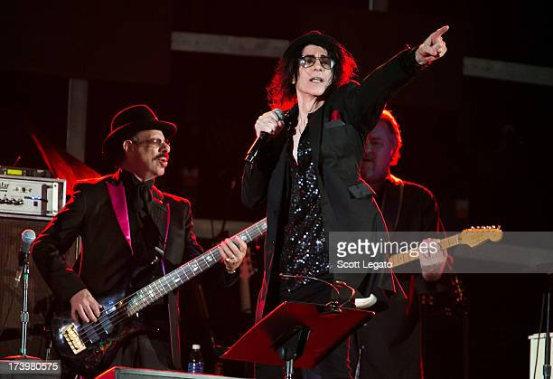 Danny Klein and Peter Wolf of the rock band J Geils performs in concert at Ford Field on July 18 2013 in Detroit Michigan