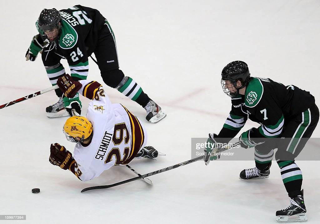 Danny Kristo #7 of North Dakota hooks Nate Schmidt #29 of Minnesota as <a gi-track='captionPersonalityLinkClicked' href=/galleries/search?phrase=Jordan+Schmaltz&family=editorial&specificpeople=8050736 ng-click='$event.stopPropagation()'>Jordan Schmaltz</a> #24 looks for the loose puck January 19, 2013 at Mariucci Arena in Minneapolis, Minnesota.