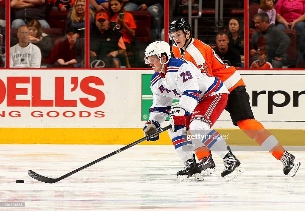 Danny Kristo of the New York Rangers tries to keep the puck from Samuel Morin of the Philadelphia Flyers on September 30 2014 at the Wells Fargo...