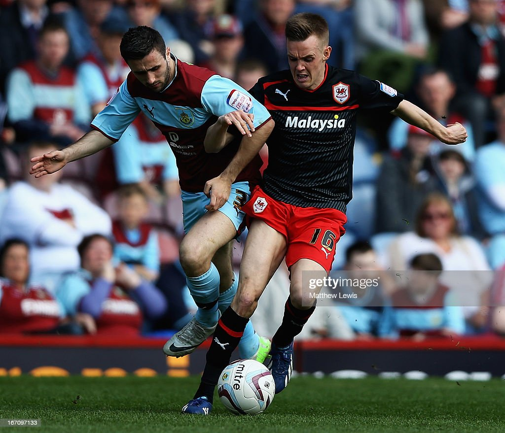 Danny Lafferty of Burnley and Craig Noone of Cardiff City challenge for the ball during the npower Championship match between Burnley and Cardiff City at Turf Moor on April 20, 2013 in Burnley, England.