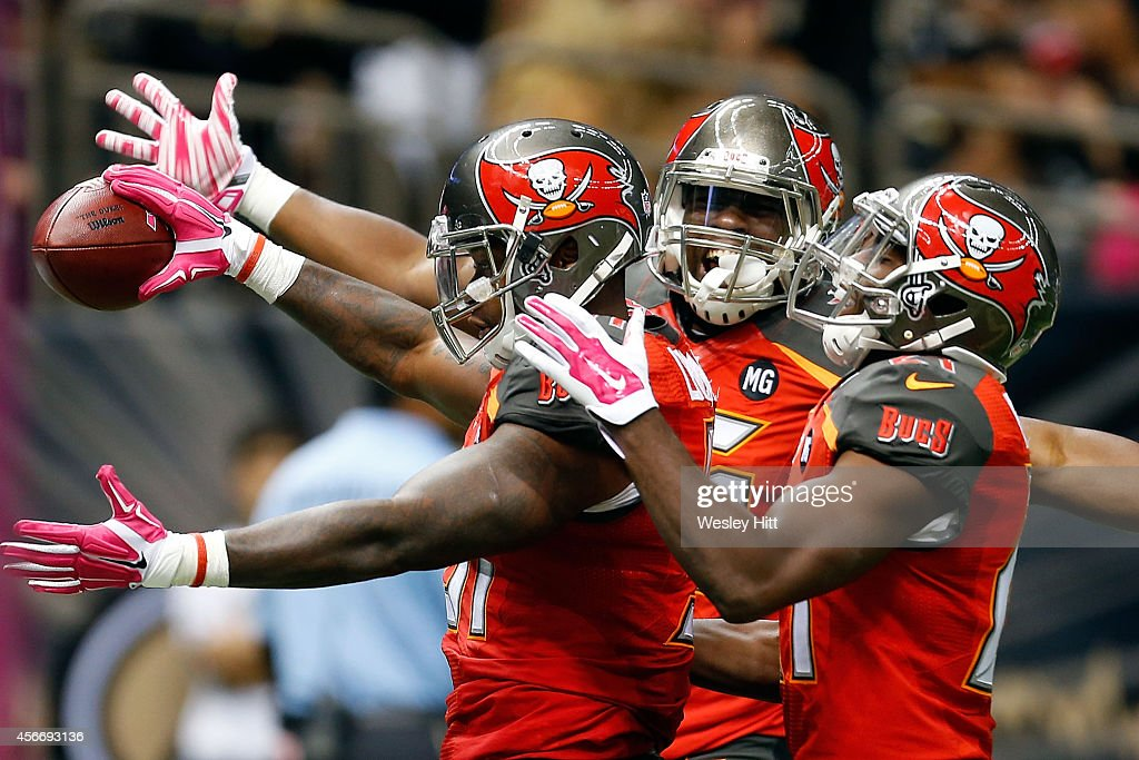 Danny Lansanah #51 of the Tampa Bay Buccaneers celebrates a touchdown during the third quarter of a game against the New Orleans Saints at the Mercedes-Benz Superdome on October 5, 2014 in New Orleans, Louisiana.