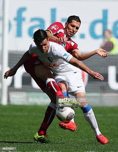 Danny Latza of Bochum is challenged by Karim Matmour of Kaiserslautern during the Second Bundesliga match between 1 FC Kaiserslautern and VfL Bochum...