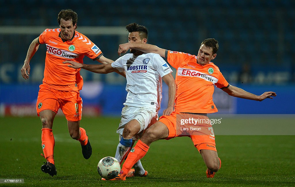 Danny Latza of Bochum is challenged by Stephan Fuerstner and Zolt Korcsmar of Fuerth during the Second Bundesliga match between VfL Bochum and SpVgg...