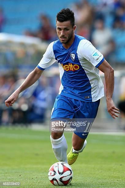 Danny Latza of Bochum runs with the ball during the preseason friendly match between VfL Bochum and FC Schalke 04 at Rewirpower Stadium on August 5...