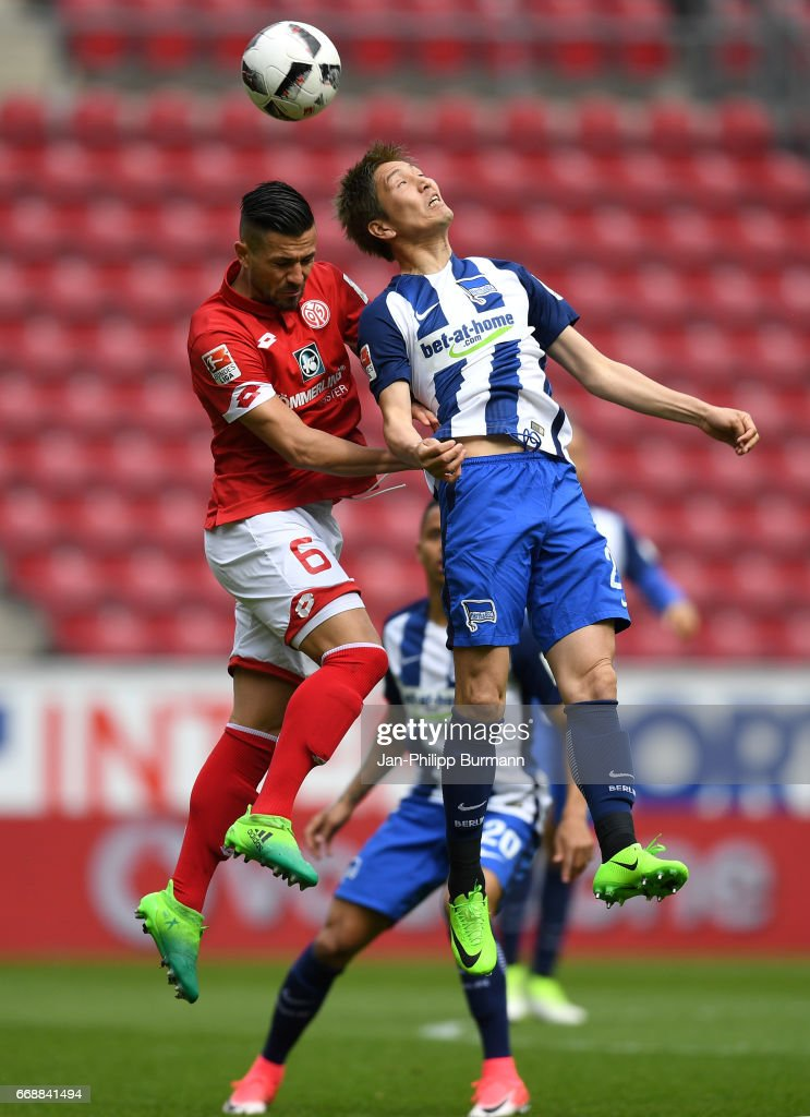 Danny Latza of FSV Mainz 05 and Genki Haraguchi of Hertha BSC during the game between FSV Mainz 05 and Hertha BSC on april 15, 2017 in Mainz, Germany.