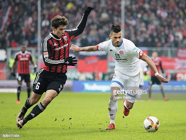 Danny Latza of FSV Mainz 05 is challenged by Alfredo Morales of Ingolstadt 04 during the Bundesliga match between FC Ingolstadt and FSV Mainz at Audi...