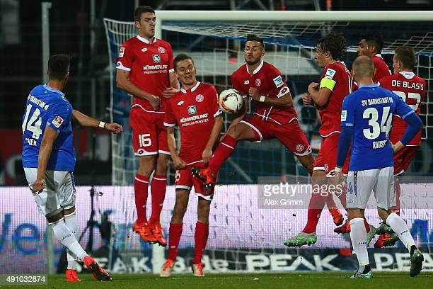 Danny Latza of Mainz blocks a freekick from Sandro Wagner of Darmstadt during the Bundesliga match between SV Darmstadt 98 and 1FSV Mainz 05 at...