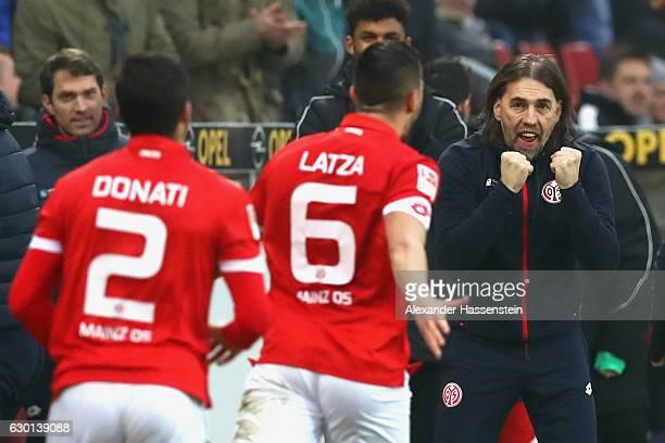 Danny Latza of Mainz celebrates scoring the 1st team goal with Martin Schmidt head coach of Mainz during the Bundesliga match between 1 FSV Mainz 05...