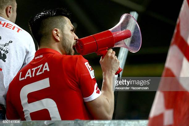 Danny Latza of Mainz celebrates victory with Mainz supporters after winning the Bundesliga match between 1 FSV Mainz 05 and Hamburger SV at Opel...