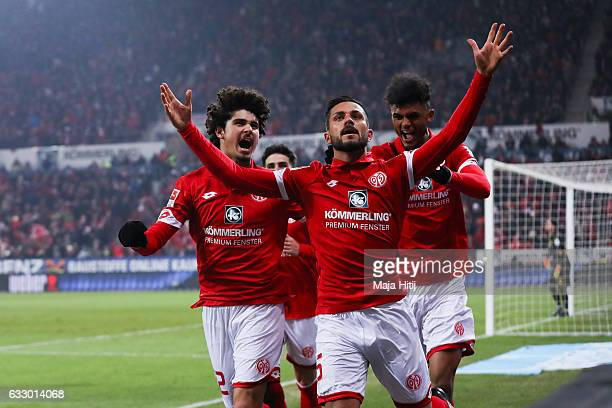 Danny Latza of Mainz celebrates with Andre Ramalho of Mainz and Aarom Seydel after he scores the equalizing goal to make it 11 during the Bundesliga...