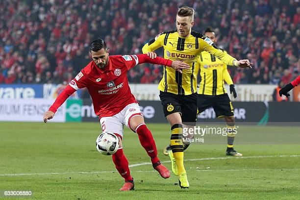 Danny Latza of Mainz fight for the ball with Marco Reus of Dortmund during the Bundesliga match between 1 FSV Mainz 05 and Borussia Dortmund at Opel...