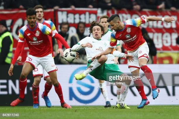 Danny Latza of Mainz is challenged by Clemens Fritz of Bremen during the Bundesliga match between 1 FSV Mainz 05 and Werder Bremen at Opel Arena on...