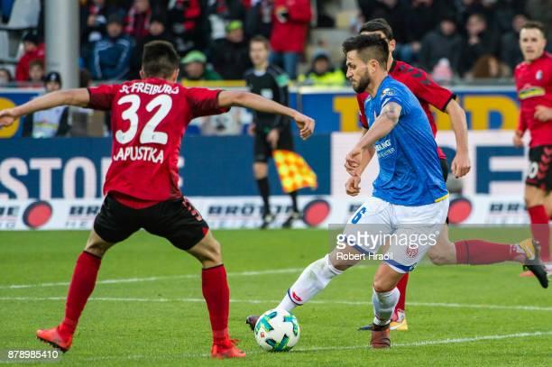 Danny Latza of Mainz vies with Bartosz Kapustka of Freiburg during the Bundesliga match between SportClub Freiburg and 1 FSV Mainz 05 at...