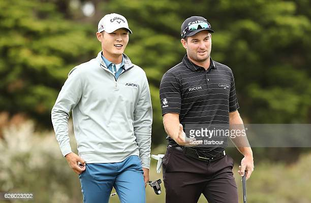 Danny Lee and Ryan Fox of New Zealand look on during day four of the World Cup of Golf at Kingston Heath Golf Club on November 27 2016 in Melbourne...