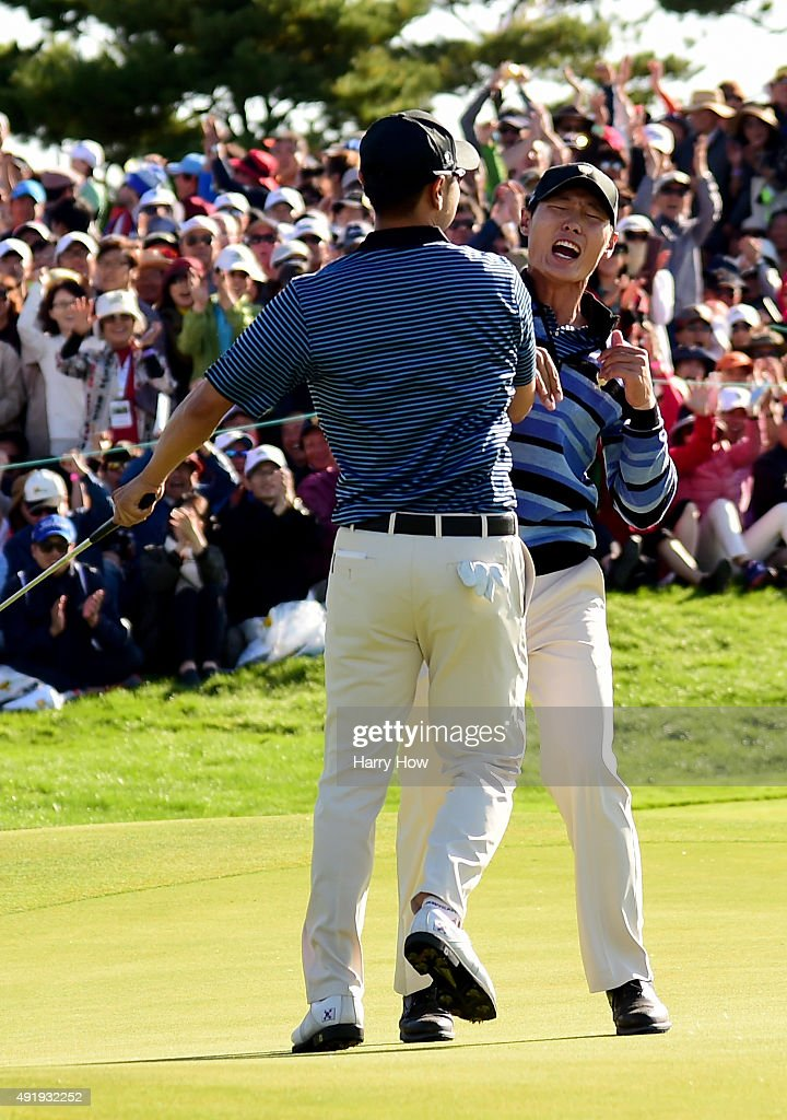 Danny Lee and SangMoon Bae of the International Team celebrate a putt to win the match on the 18th green during the Friday fourball matches at The...