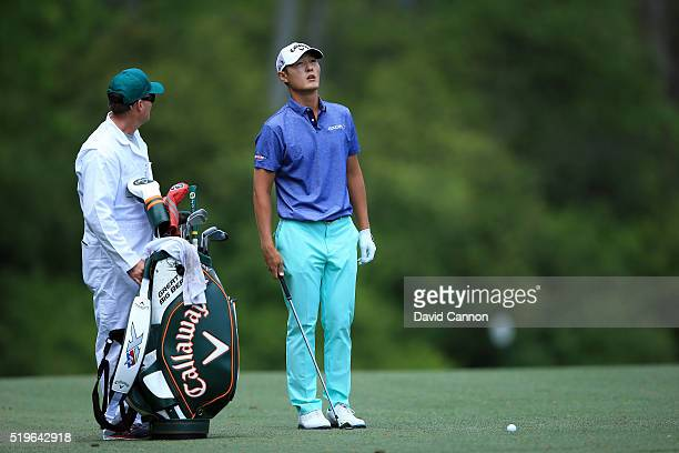Danny Lee of New Zealand and caddie Mike Hartford stand on the fifth hole during the first round of the 2016 Masters Tournament at Augusta National...