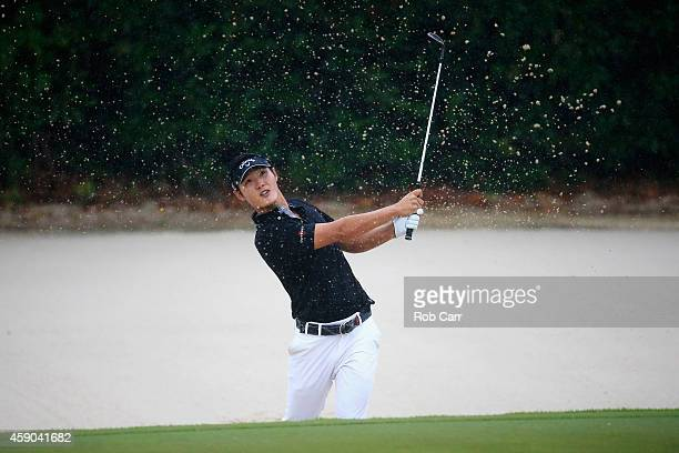 Danny Lee of New Zealand hits a shot out of the bunker on the 16th hole during the third round of the OHL Classic at Mayakoba on November 15 2014 in...