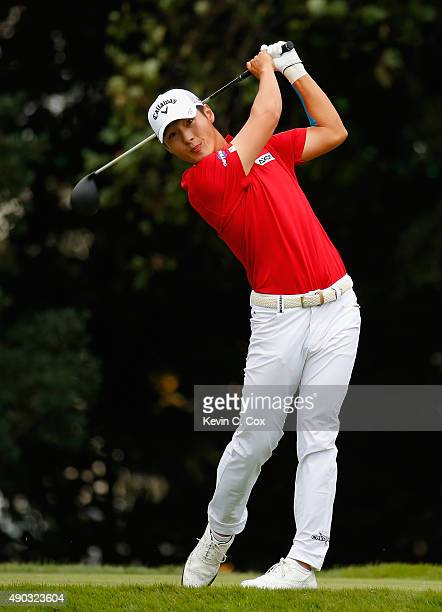 Danny Lee of New Zealand hits his tee shot on the eighth hole during the final round of the TOUR Championship By CocaCola at East Lake Golf Club on...
