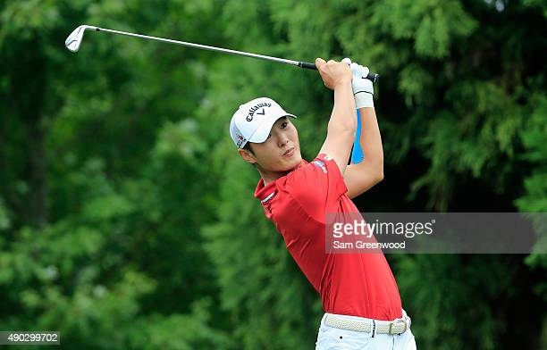 Danny Lee of New Zealand hits his tee shot on the second hole during the final round of the TOUR Championship By CocaCola at East Lake Golf Club on...