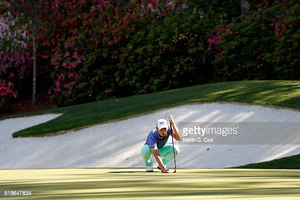 Danny Lee of New Zealand lines up a putt for birdie on the 13th green during the first round of the 2016 Masters Tournament at Augusta National Golf...