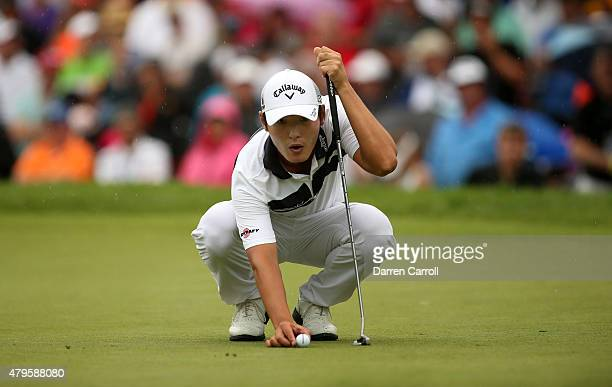 Danny Lee of New Zealand lines up a putt on the 18th hole during a playoff against David Hearn of Canada Robert Streb and Kevin Kisner during the...