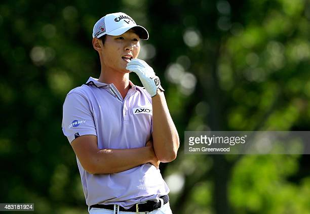 Danny Lee of New Zealand looks on from the ninth tee during the first round of the World Golf Championships Bridgestone Invitational at Firestone...
