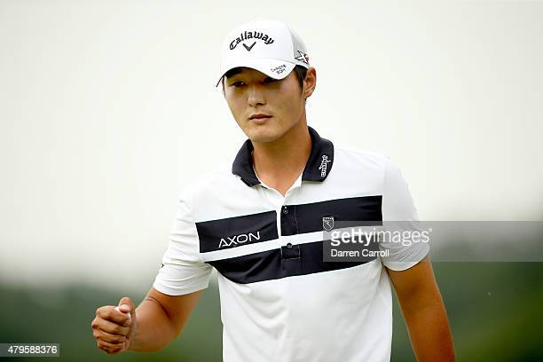 Danny Lee of New Zealand picks up the ball after putting on the 17th hole during the final round of the Greenbrier Classic held at The Old White TPC...