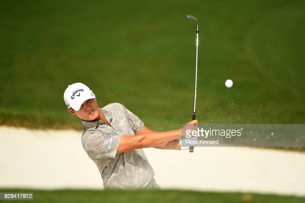 Danny Lee of New Zealand plays his shot out of the bunker on the first hole during the first round of the 2017 PGA Championship at Quail Hollow Club...