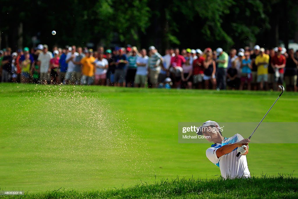 Danny Lee of New Zealand takes a shot from a bunker on the 17th hole during the final round of the John Deere Classic held at TPC Deere Run on July 12, 2015 in Silvis, Illinois.