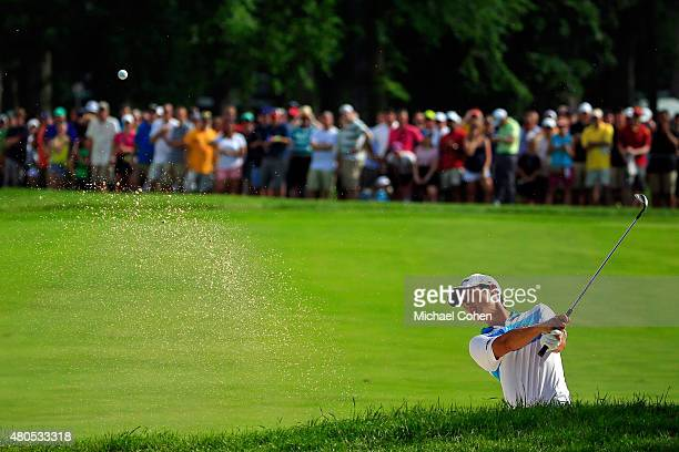 Danny Lee of New Zealand takes a shot from a bunker on the 17th hole during the final round of the John Deere Classic held at TPC Deere Run on July...