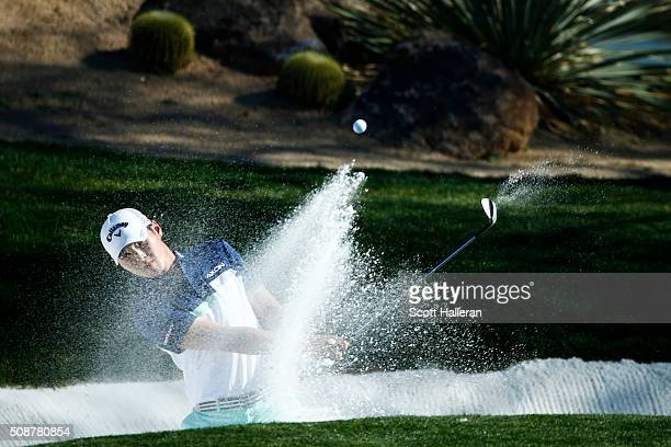 Danny Lee of New Zealand takes his shot out of the bunker on the 12th during the third round of the Waste Management Phoenix Open at TPC Scottsdale...