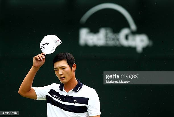 Danny Lee of New Zealand tips his hat to the crowd on the 18th hole during the final round of the Greenbrier Classic held at The Old White TPC on...