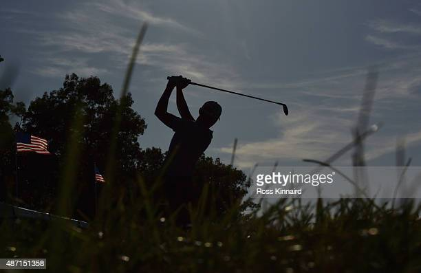Danny Lee of New Zealand watches his tee shot on the par four 17th hole during the third round of the Deutsche Bank Championship at TPC Boston on...