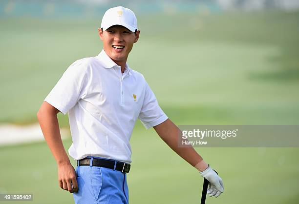 Danny Lee of the International smiles on the driving range during a practice round prior to the start of The Presidents Cup at the Jack Nicklaus Golf...