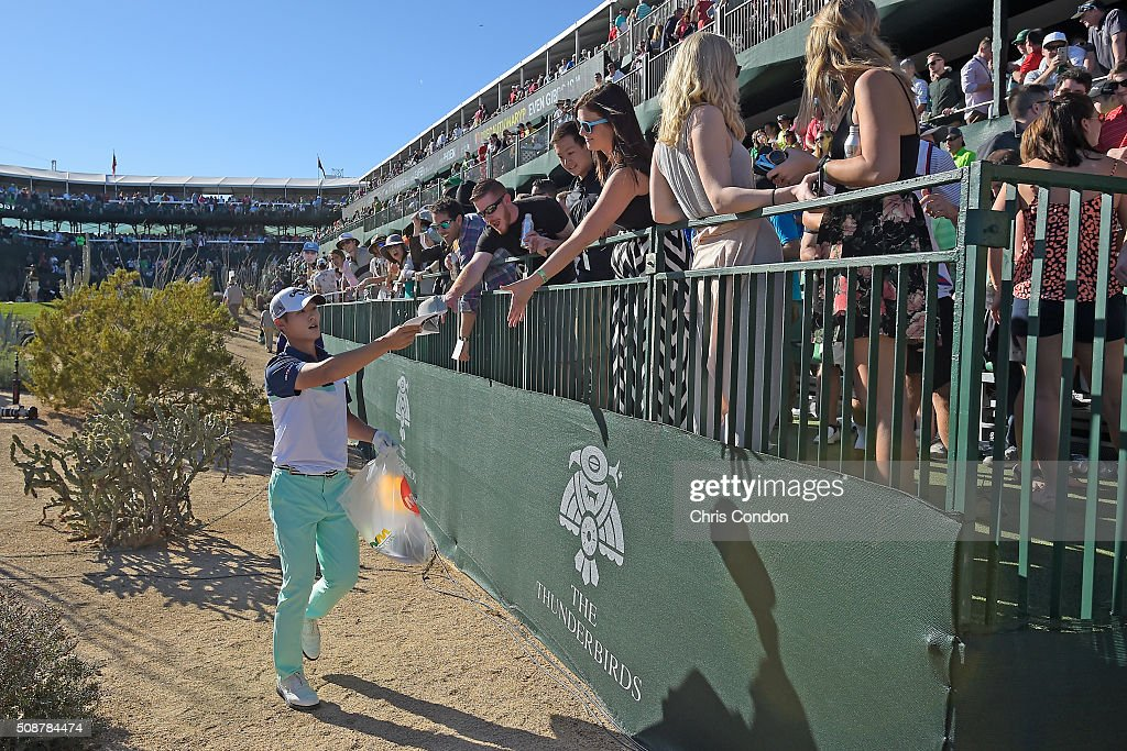 <a gi-track='captionPersonalityLinkClicked' href=/galleries/search?phrase=Danny+Lee+-+Golfer&family=editorial&specificpeople=5504075 ng-click='$event.stopPropagation()'>Danny Lee</a> passes out gifts to fans on the 16th hole during the third round of the Waste Management Phoenix Open, at TPC Scottsdale on February 6, 2016 in Scottsdale, Arizona.
